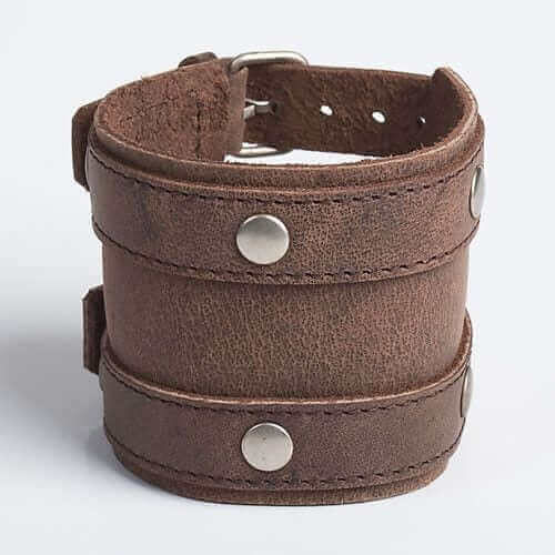stylish brown leather band featuring several bullets around the outer edge