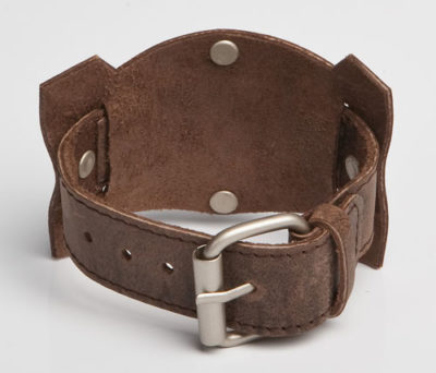 cool brown or black leather wristband featuring six pins and a stainless steel ring in the middle
